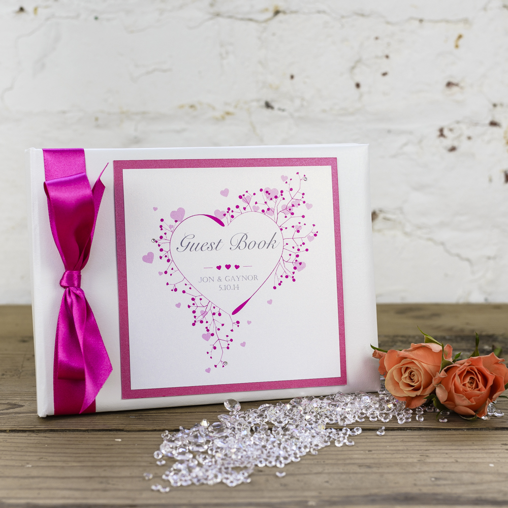Stunning guest book in White featuring a heart design printed onto ...